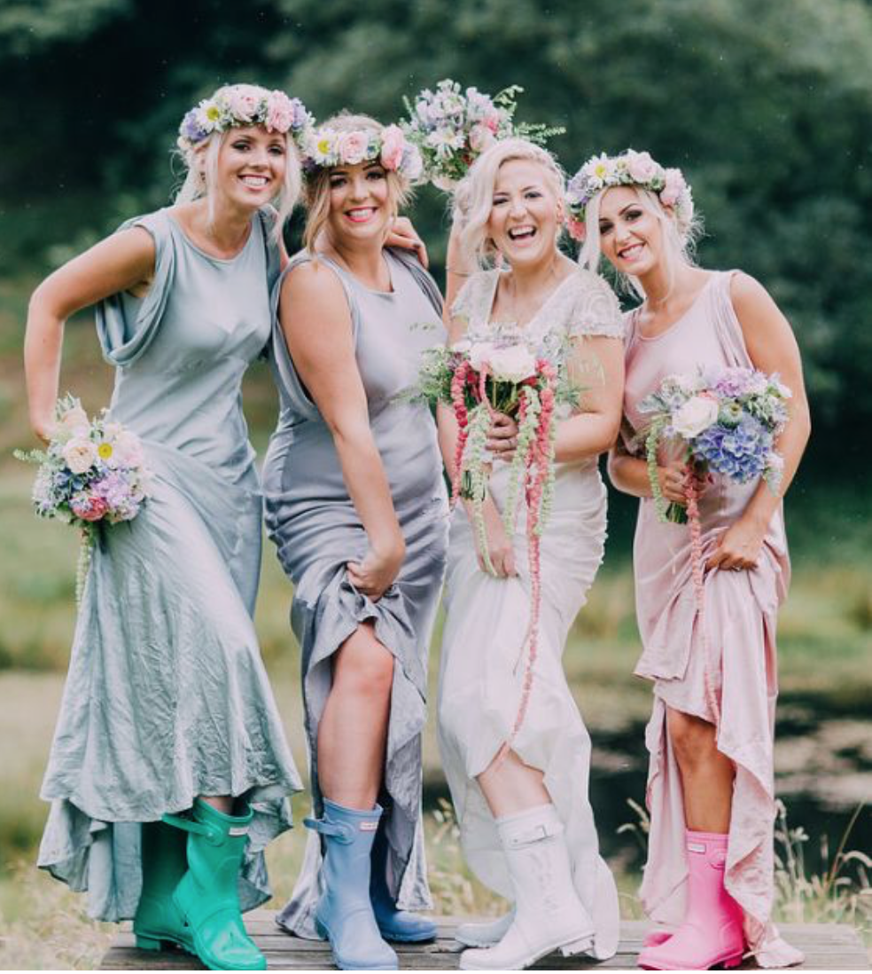 Bride and bridesmaid in wellies