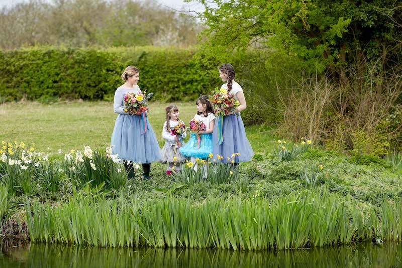 country wedding bridesmaids bright flowers