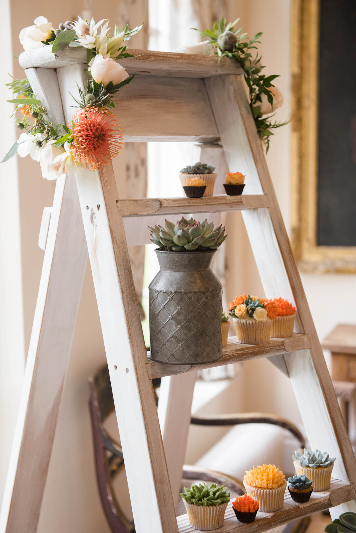 Wedding ladder with Orange flowers and floral cupcakes