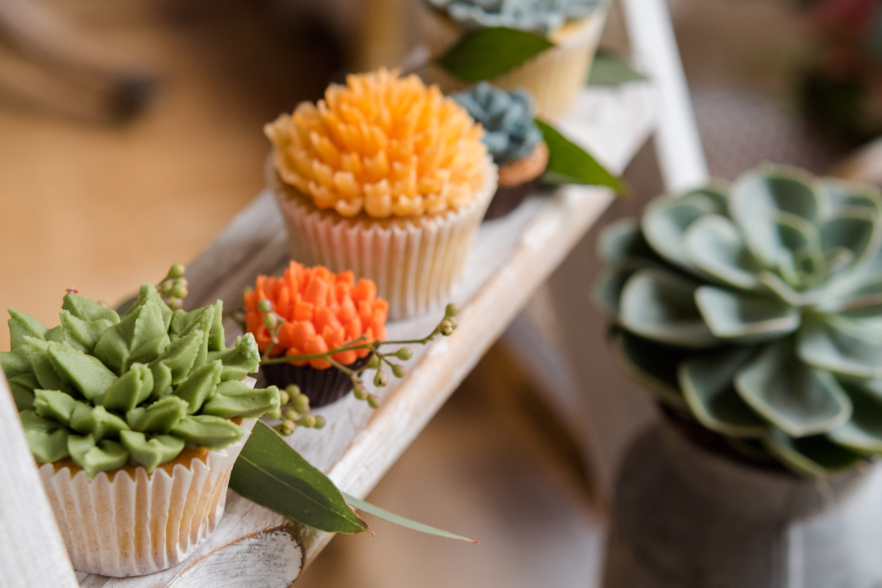 Handmade floral and succulent cupcakes