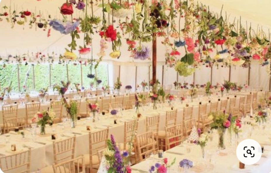 hanging flower display in a wedding marquee